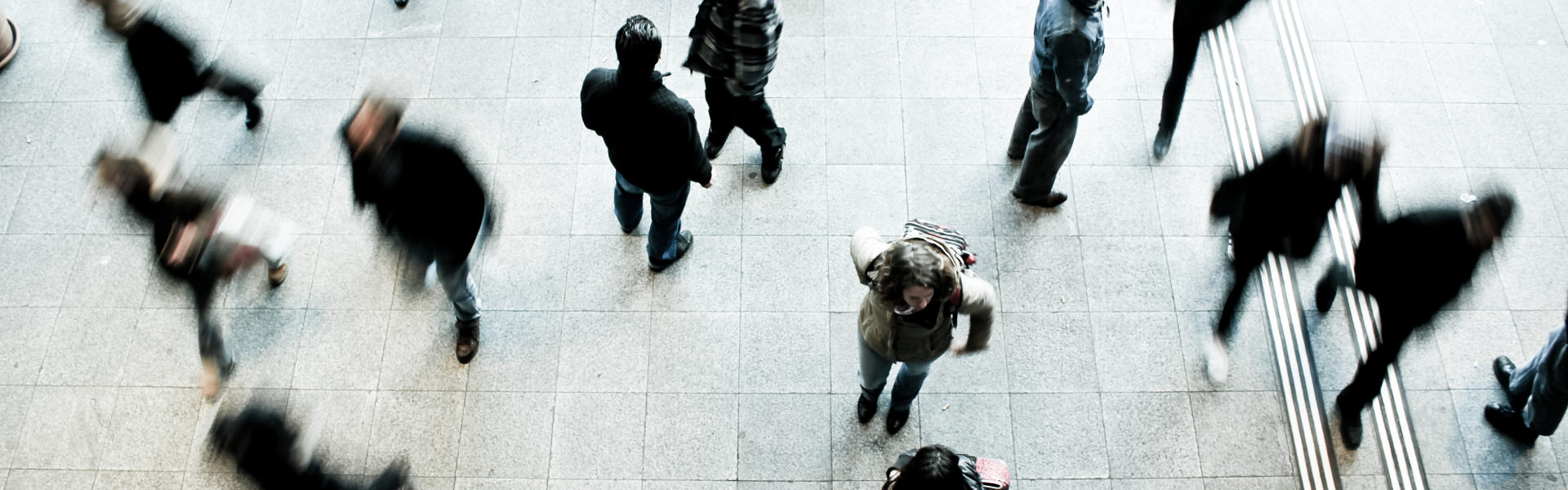 Overhead view of people walking and talking in a public space