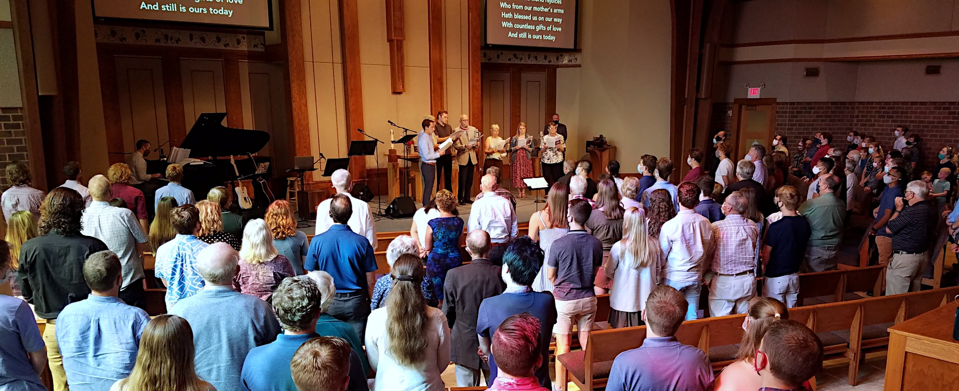 People worshiping in the sanctuary at Wisconsin Lutheran Chapel