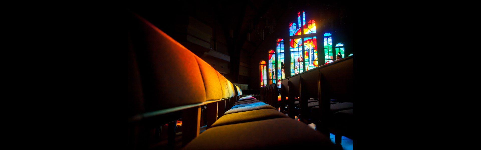 Light shining through the stained glass windows in the Chapel sanctuary